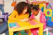 Girl learn alphabet in early development class