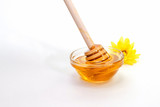 fresh honey with yellow flower on light background