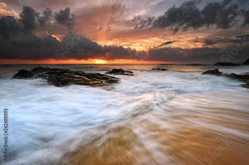 Rushing waves over the rocky beach in Pantai Kemasik, Terengganu Malaysia