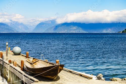 Acrylglas Pier Old boat on pier, norway fjord