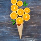 Fresh oranges on dark wooden background