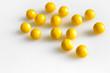 Quadro yellow round pills vitamins bada on white table close up