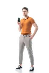 handsome man holding smartphone with booking app on screen isolated on white