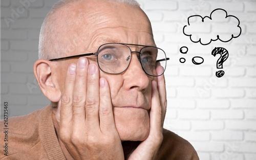 canvas print picture Seniors portrait of sad old caucasian man