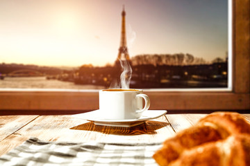 Fresh coffee with croisant and Paris landscape.