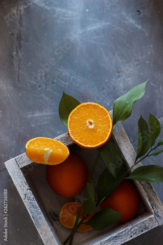 canvas print picture oranges fruit in box on a grey background