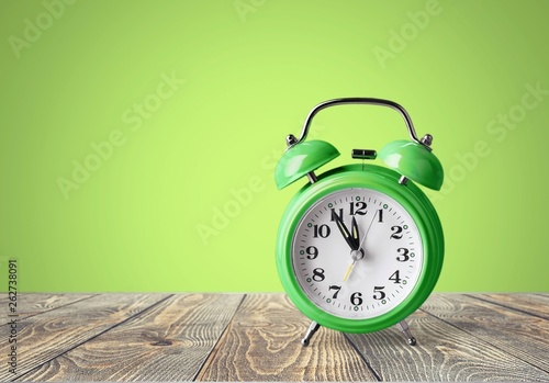 Retro alarm clock on table  background