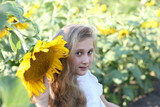 beautiful girl of 10 years in the sunflower field of sunflowers