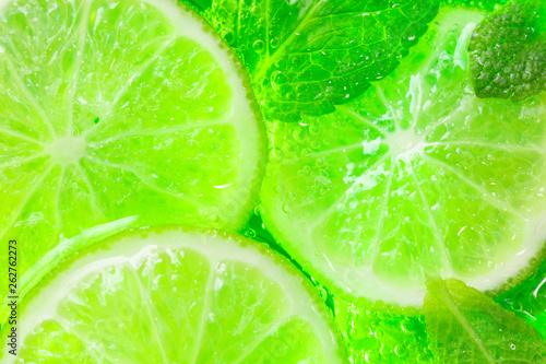 Leinwandbild Motiv lime and mint close-up Mojito cocktail