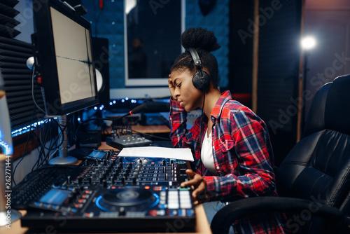 Female sound operator in audio recording studio - 262771444