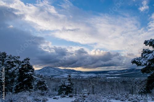 canvas print picture cloud landscape over snowy mountains