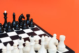 Chess board with figures on blue background top view copy space. Chess game concept.