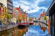 Leinwandbild Motiv Channel in Amsterdam Netherlands houses river Amstel landmark old european city spring landscape.