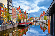 "Постер, картина, фотообои ""Channel in Amsterdam Netherlands houses river Amstel landmark old european city spring landscape."""