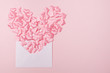 Small pink hearts with envelope, on pink background with copy space