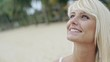 Smiling blond woman deeply in love