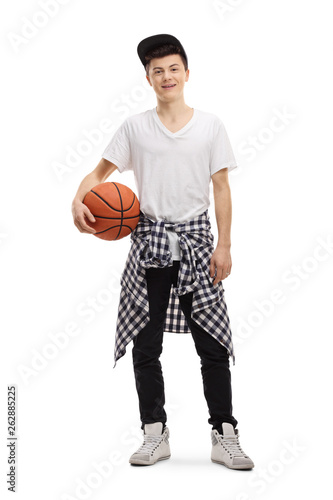 Fototapeten Basketball Male teenager posing with a basketball