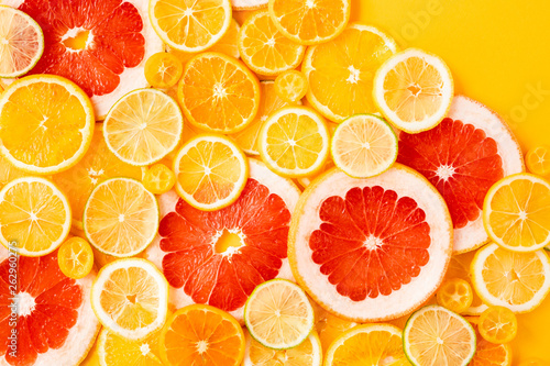 Juicy fresh bright summer yellow background with citrus fruits, flat lay. Sliced mixed citrus fruits, concept of healthy eating, detox, dieting, top view and flatlay. - 262960275