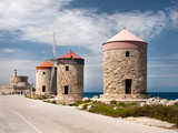 The three remaining Windmills located on the wave breaker of Mandraki harbour in Rhodes