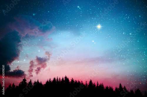 Colorful dramatic sky with stars .