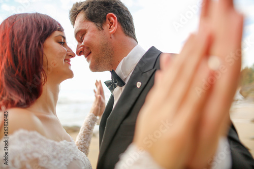 canvas print picture Happy wedding couple posing outdoor near beach