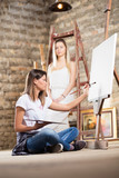 Young female artist and model indoors