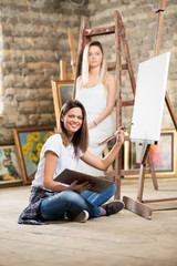 Young female artist and model posing
