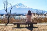 alone girl on chair see view sightseeing Fuji mountain lake views kawaguchiko Japan