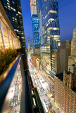 Amazing skyscrapers in Midtown Manhattan, aerial view from rooftop with traffic reflections on the buildings at night - 263079031