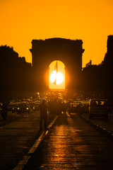 Parishenge, famous event with a stunning sunset under the Arc de Triomphe