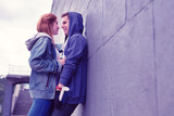 Passionate young couple having lovely moments while leaning on the wall
