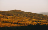 Sunset on hills ladnscape, forest, farm, summer travel