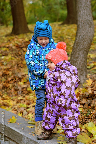 Concept of children life. Little child having fun in park. Happy child playing in the nature . Kid having fun outdoors