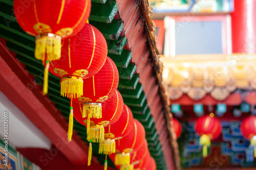 red lanterns of buddha temple, horisontal shot, selective focus © Schum