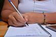 writing in a bullet journal, pen in hand
