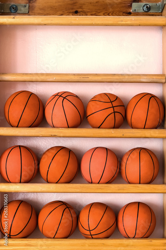 Fototapeten Basketball three rows of basketballs on the gym wooden stairs, vertically