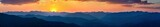 Fototapeta Coffie - Sunset over mountains in South Mexico © Leonid Andronov