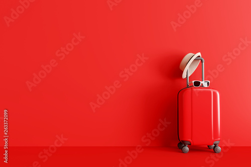 Suitcase with hat and sunglasses on red background. travel concept. minimal style. 3d rendering © aanbetta