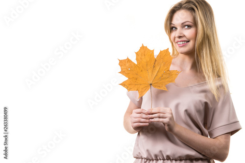 Woman holding maple leaf in hand