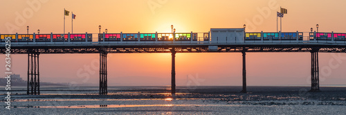 Dawn With Sun Rising Behind Worthing Pier at Low Tide