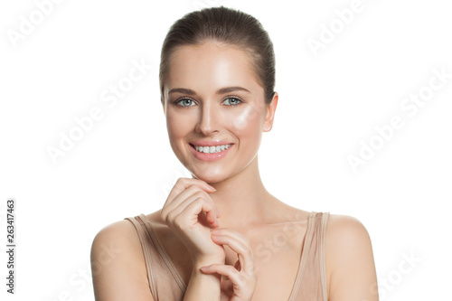 canvas print picture Cheerful woman with clear skin smiling. Pretty girl isolated