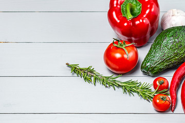 set of ripe vegetables on a white wooden background with a place for copy space