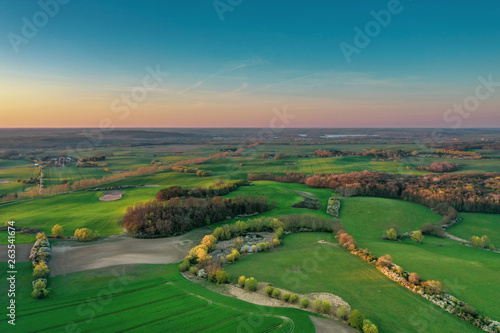 Aerial view of agricultural fields during sunset  © tl6781