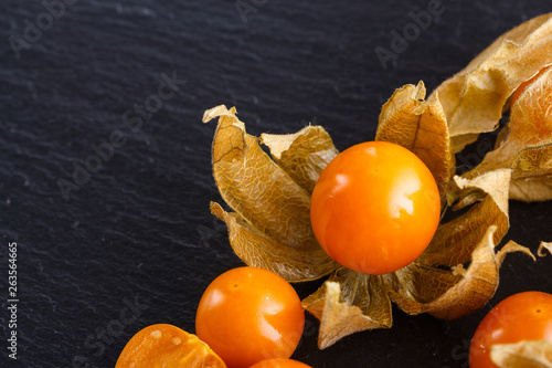 canvas print picture juicy winter cherry on a dark stone background