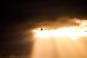 Silhouette airplane flying