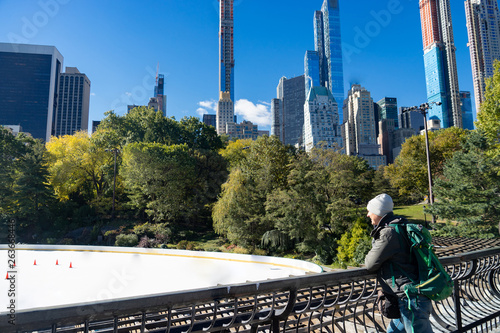 Man looking at empty Ice Rink at Central Park in winter