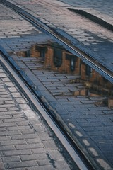 old railway tracks in the station in the street. train tracks in the city. Bilbao. Spain