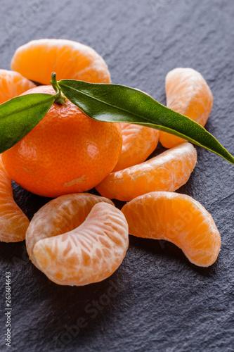 canvas print picture juicy mandarin on a dark stone background