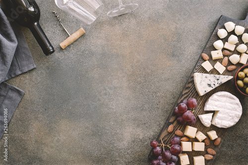 Cheeseboard with various cheeses, grapes, olives and nuts - 263694086