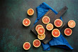 canvas print picture - Red blood orange fruit on a dark green background. Oranges Slices. Healthy Food